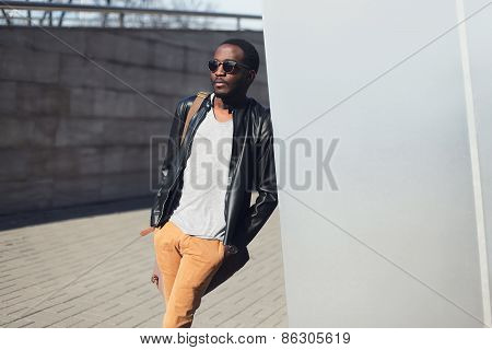 Street Fashion Concept - Handsome Stylish African Man Standing In The City Against A Metal Wall