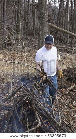 Man buring brush