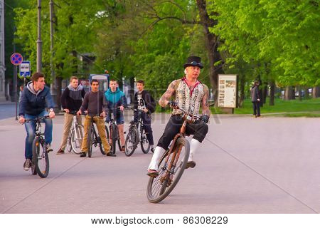 Unusual man rides on retro bike in Vilnius, Lithuania
