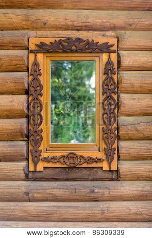 Window With Wooden Architraves In The Wooden House