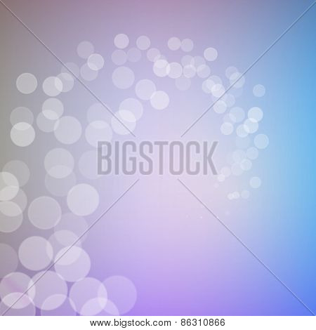 Abstract bokeh sparkles swirl on blurred background