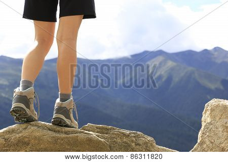 hiking woman on mountain peak of tibet,china