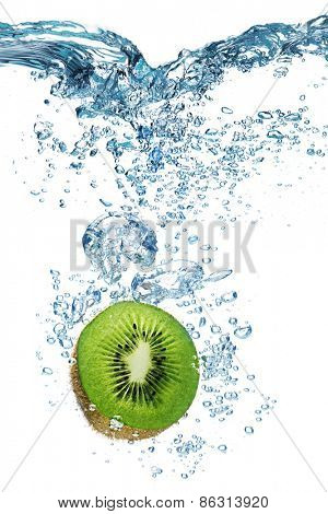 Fresh kiwi dropped into water with splash isolated on white