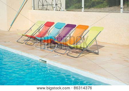 Row colorful chairs at the swimming pool
