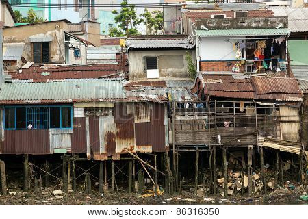 Poor shanty wooden house on the Saigon river bank in Ho Chi Minh city, Vietnam