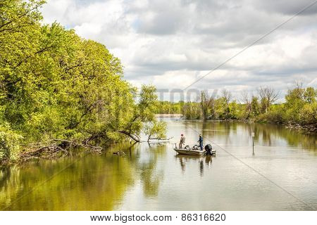 Men in boat fishing on a river