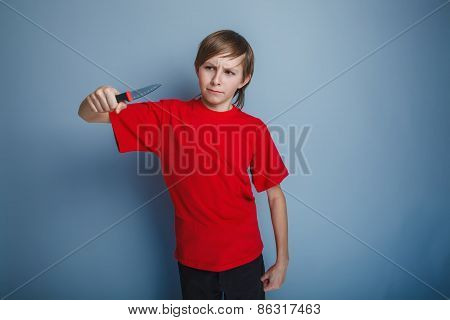 boy teenager European appearance in a red shirt brown hair looks