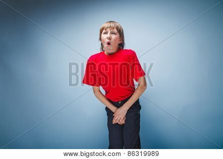 teenager boy in red T-shirt European appearance brown hair hands