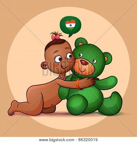 Little Indian girl hugging teddy bear green.