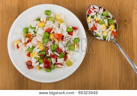 Vegetable Mix On Plate And Spoon On Wooden Table