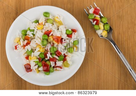 Vegetable Mix On Plate And Fork On Wooden Table
