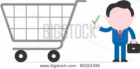 Businessman Showing Check Mark Beside Big Shopping Cart