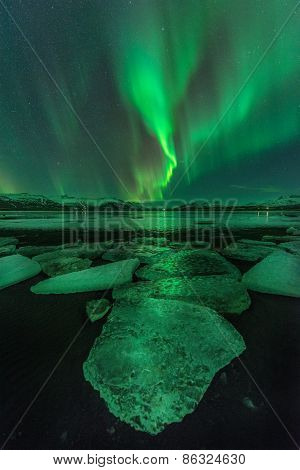 A beautiful green aurora over the Jokulsarlon lagoon Iceland