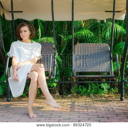 Woman sitting on the swingset