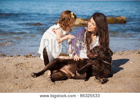 Happy Family At The Beach