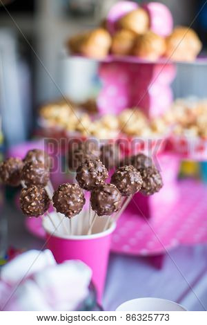 Chocolate cakepops on holiday dessert table at kid birthday party