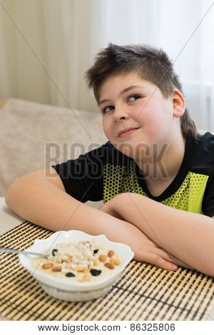 Teenager boy refuses to eat oatmeal for breakfast