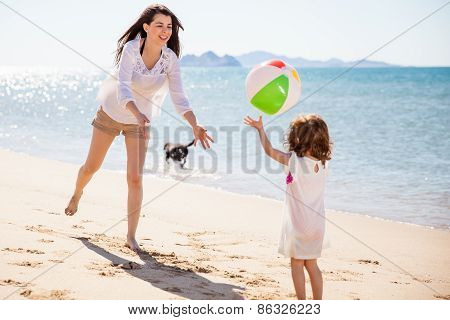 Woman Playing With A Beach Ball