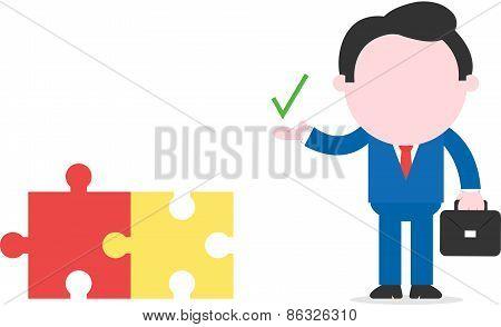 Businessman Showing Check Mark Beside Puzzle Pieces