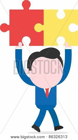 Businessman Walking And Holding Puzzle Pieces