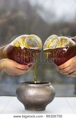 Two Jars With Honey, Pot And Four Woman's Hands