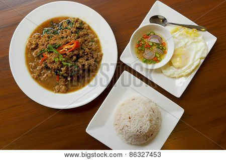 a set of chili basil with rice and egg