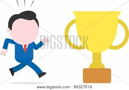 Businessman Running To Gold Trophy