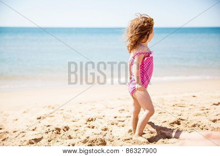 Little Girl Looking At The Ocean