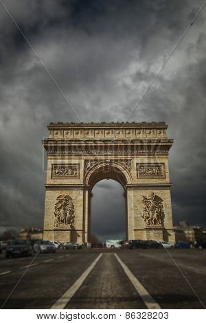 Arc the Triomphe with a grey and cloudy sky in Paris, France