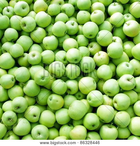 Green apples pile background.
