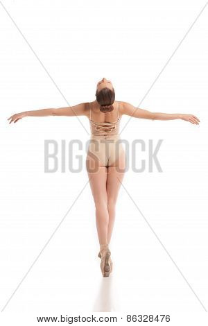 Back view of young modern ballet dancer isolated on white background