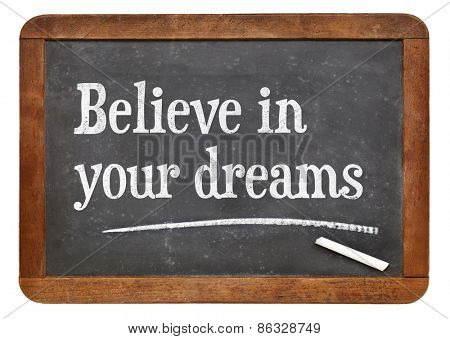 Believe in your dreams. Motivational words on a vintage slate blackboard