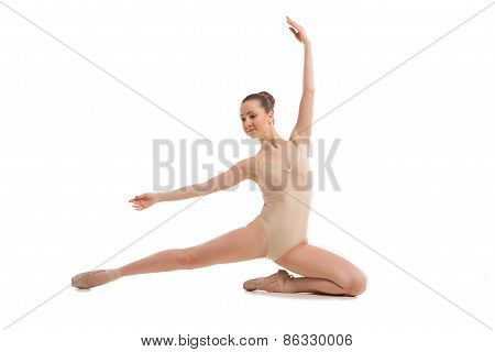 young pretty ballet dancer sitting in elegant pose