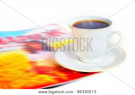 A Cup Of Hot Coffee And A Magazine