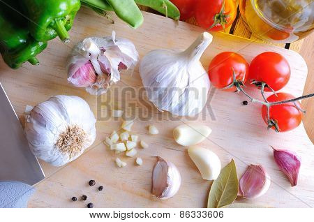 Prepared White Garlic On A Cutting Table Top View