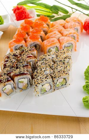 Sushi Set On White Plate Over Wooden Background