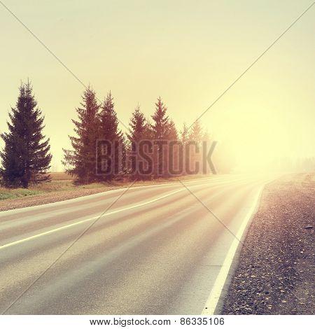 Vintage photo of empty rural road.