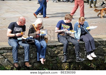 Family eating fish and chips.