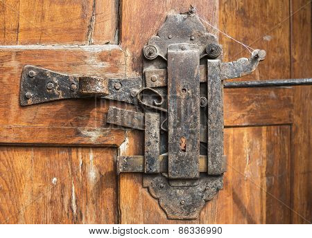 Historical Padlock On The Wooden Door