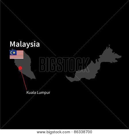 Detailed map of Malaysia and capital city Kuala Lumpur with flag on black background