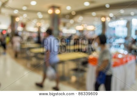 Blurred People Walking In The Food Court