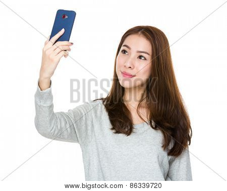 Young Asian woman using a smart phone for self photo