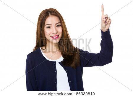 Woman smiling pointing up showing copy space