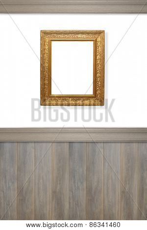 Antique ornate gilt frame on wall left blank for advertising