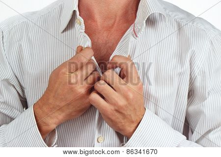 Hands a man fastened the buttons on the bright shirt closeup