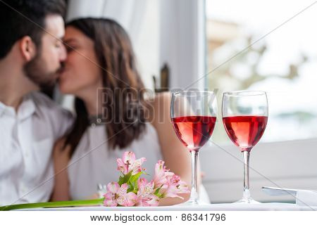 Detail Of Wine Glasses With Couple In Background.
