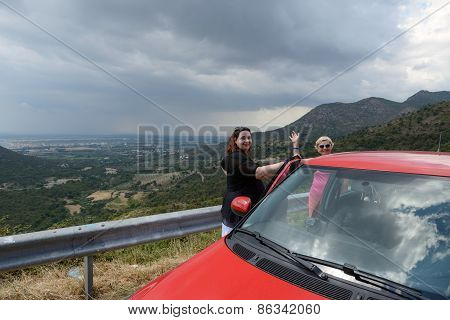 Women On Scenic Landscape Of Cap De Creus Background, Spain.