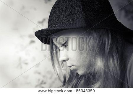 Monochrome Closeup Profile Portrait Of Blond Girl In Black Hat