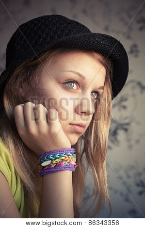 Portrait Of Beautiful Blond Girl In Hat And Rubber Loom Bracelets