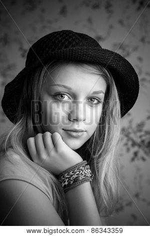 Monochrome Portrait Of Blond Teenage Girl In Black Hat